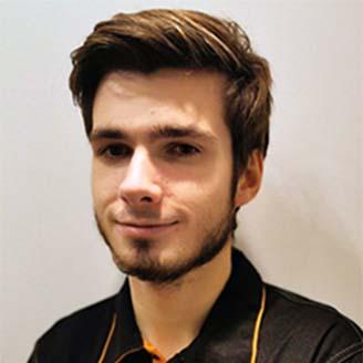 Headshot of Gustas Grinbergas
